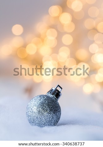 christmas decoration in front of blurred lightening - stock photo