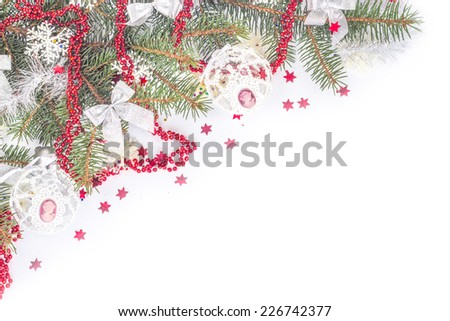 Christmas decoration in red color on a Christmas tree. Isolated on a white background. - stock photo