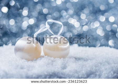 Christmas decoration in snow on abstract background - stock photo