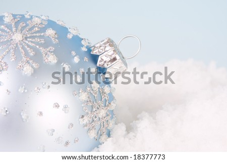 Christmas decoration in soft blue pastels in the snow - stock photo