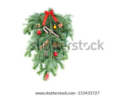 Christmas decoration made of spruce on white background - stock photo