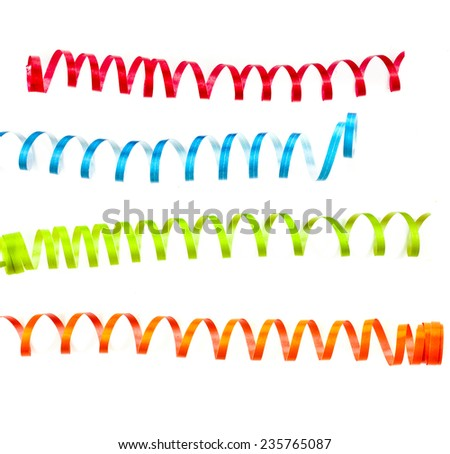 Christmas decoration of beautiful curling colorful streamers isolated on white - stock photo