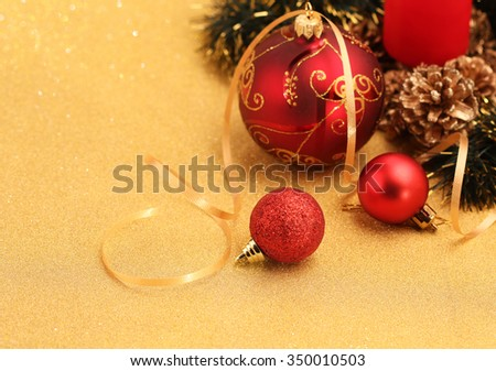 Christmas decoration on gold glitter background - stock photo
