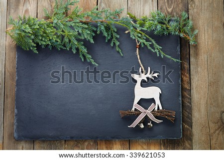 Christmas decoration  on slate and wood background. - stock photo