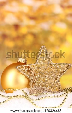 Christmas decoration on yellow background - stock photo
