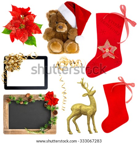 Christmas decoration ornaments isolated on white background. Santas hat, red stocking, gift box, deer, tablet pc with golden ribbon bow, chalkboard with christmas tree branches - stock photo