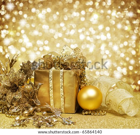 Christmas Decoration over Glittering Golden Background - stock photo