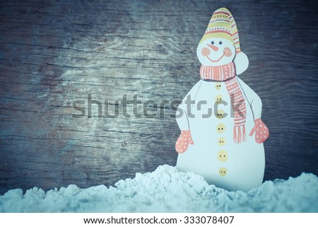 Christmas decoration over grunge background/vintage paper handmade christmas decoration and snow on wooden background with copy space. - stock photo