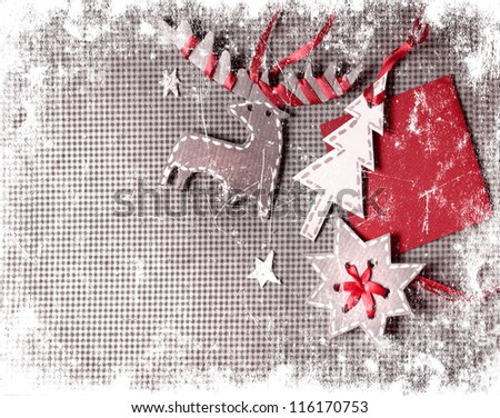 Christmas decoration over grunge paper background/old paper bordering with christmas decoration with a sign - stock photo