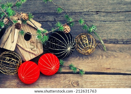 christmas decoration over rustic wooden background. red and black china style balls and baubles. retro style toned picture - stock photo
