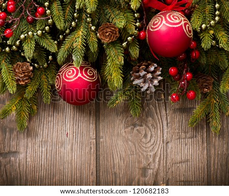Christmas Decoration Over Wooden Background. Decorations over Wood. Vintage - stock photo