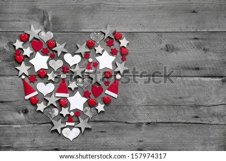 Christmas decoration shaped heart on grey wooden background  - stock photo