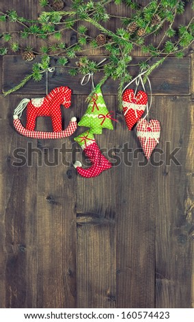christmas decoration textile handmade toys over rustic wooden background. nostalgic picture with retro style design - stock photo