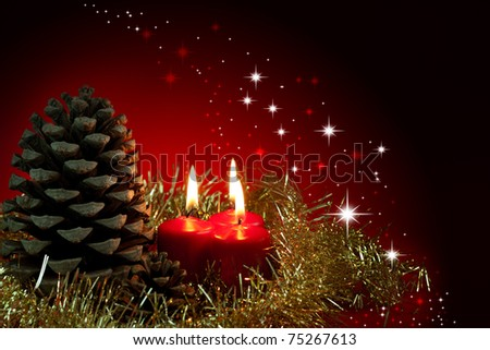 Christmas decoration.Three red burning candles and pinecone - stock photo