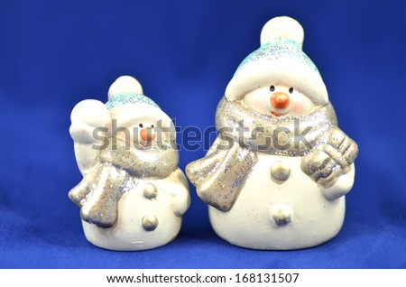 christmas decoration, two figures of snowman on blue background  - stock photo