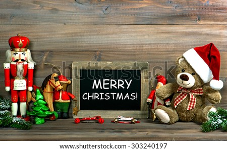 Christmas decoration with antique toys and blackboard. Vintage style toned picture with sample text Merry Christmas - stock photo
