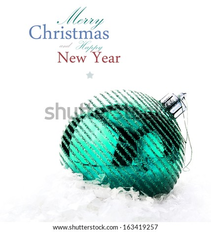 Christmas decoration with  big bauble and snow  (with easy removable sample text) - stock photo