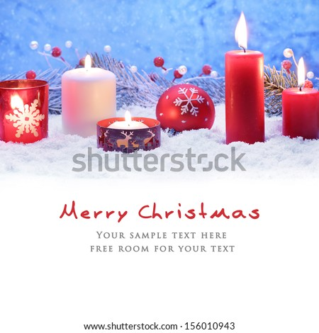 Christmas decoration with candles and ball on snow. - stock photo