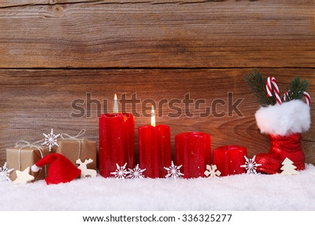christmas decoration with candles for advent season two candles burning - stock photo