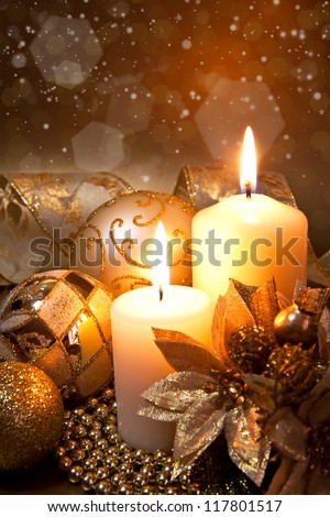 Christmas decoration with candles over dark background - stock photo
