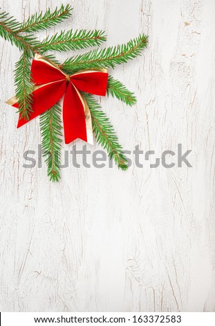 Christmas decoration with fir branch and red bow  - stock photo