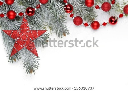 Christmas decoration with fir branch,Christmas star and balls. - stock photo