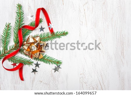 Christmas decoration with fir branch, red ribbon and bow - stock photo