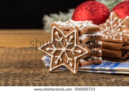 Christmas decoration with gingerbread cookies on wooden background - stock photo