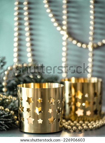 christmas decoration with golden lanterns and defocused lights. selective focus - stock photo