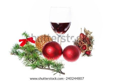 Christmas decoration with green pine and blue snow round ball ornaments for Christmas tree with one glass of wine.Holiday decorations isolated on white background. Empty space for holiday greeting card - stock photo