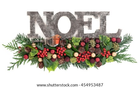 Christmas decoration with old wooden noel sign with a robin and red gold bauble decorations, holly, ivy, pine cones, cedar cypress and fir leaf sprigs over white background. - stock photo