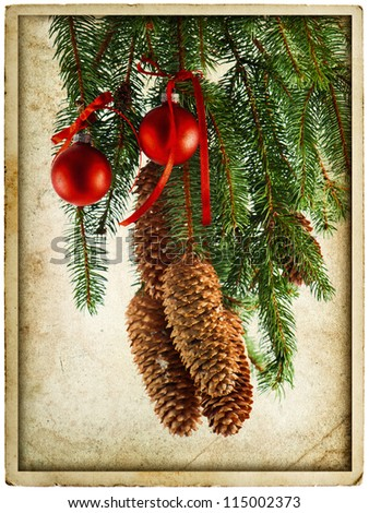 christmas decoration with red balls and fir tree branch. vintage card concept - stock photo