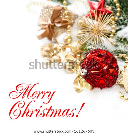 christmas decoration with red baubles and golden gift box on white background. Greetings card concept with sample text Merry Christmas! - stock photo