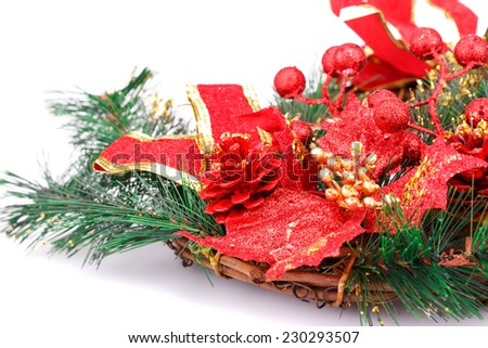Christmas decoration with red cone, leaves, ribbon  and fir-tree branch. - stock photo