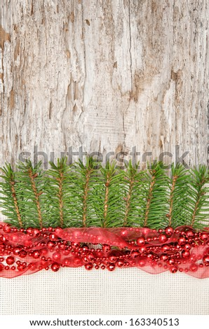 Christmas decoration with red garland, canvas and fir branch  - stock photo