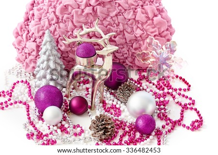 Christmas decoration with reindeer, pine tree, ornaments. - stock photo