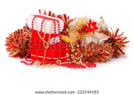 Christmas decoration with Santa's red boot, garland, beads isolated on white background. - stock photo