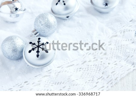 Christmas Decoration with Silver Ornaments on white background, close up selective focus - stock photo