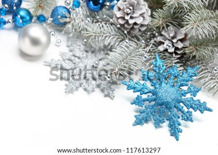 Christmas decoration with snowflake and frosty branch. - stock photo