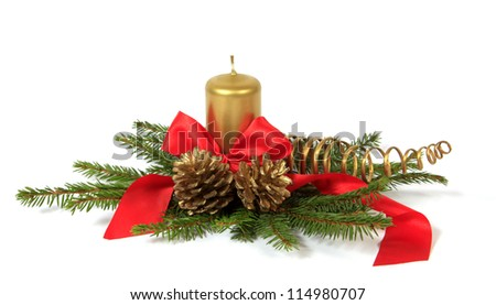 Christmas decoration with the cones, candle and twigs of the spruce - stock photo