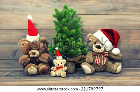 christmas decoration with vintage toys teddy bear family. retro style toned picture - stock photo