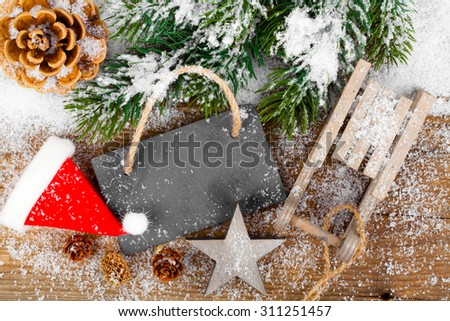 Christmas decoration with xmas canes, over wooden background - stock photo