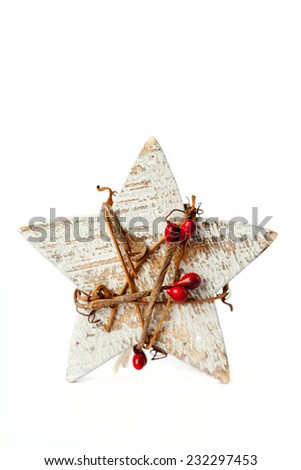 Christmas decoration: wooden star on white - stock photo