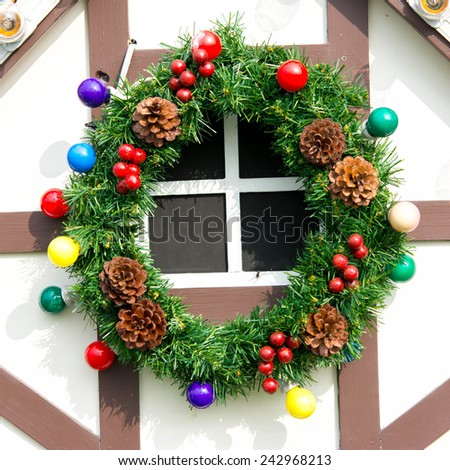 Christmas decoration wreath with red holly berries isolated   - stock photo