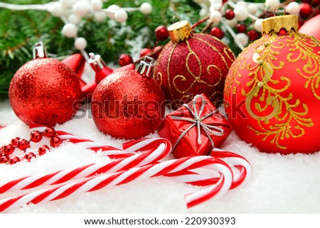 Christmas decorations and Christmas tree on a snow background - stock photo