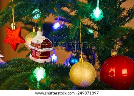 Christmas decorations and color lights on artificial fir tree - stock photo