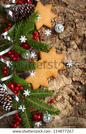 Christmas decorations and cookies on wooden background - stock photo