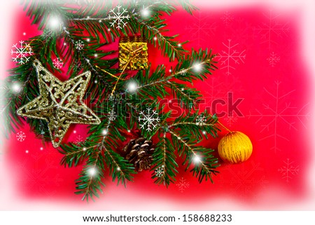 Christmas decorations and fir branch on red background - stock photo