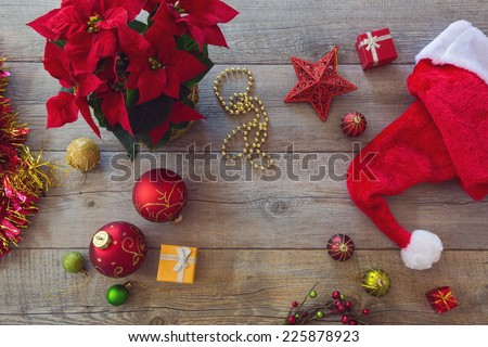 Christmas decorations and ornament on wooden background. View from above - stock photo