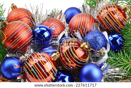 Christmas decorations and spruce twigs isolated on white background - stock photo